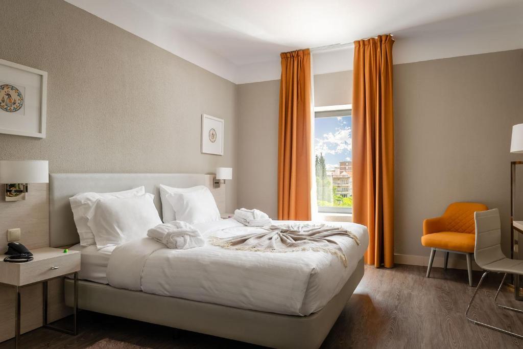 Un ou plusieurs lits dans un hébergement de l'établissement Hotel D. Luis - Elvas