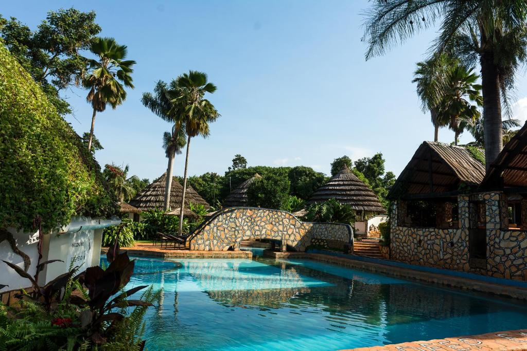 The swimming pool at or near Kingfisher Safaris Resort Hotel