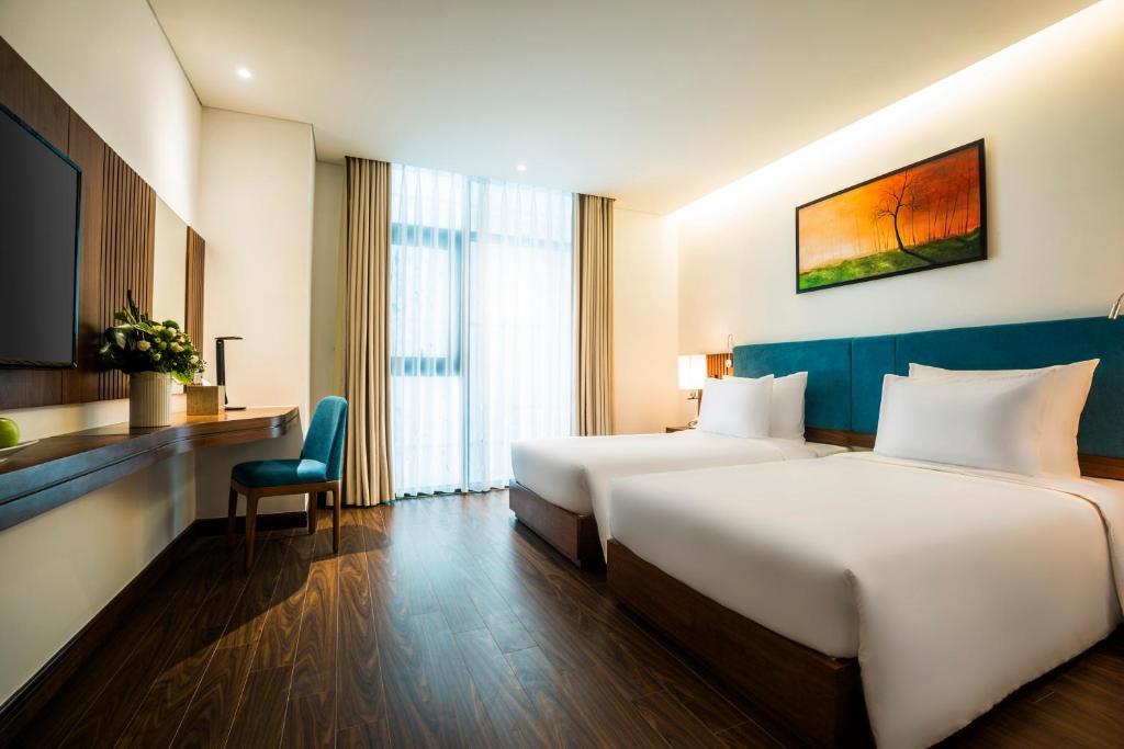 Phòng Deluxe 2 Giường Đơn - Bao Gồm Trà Chiều