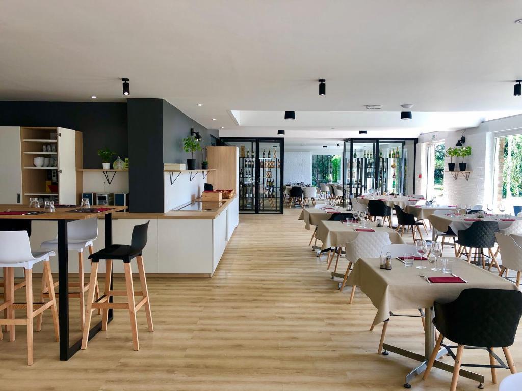 Restaurant ou autre lieu de restauration dans l'établissement Altia Hôtel