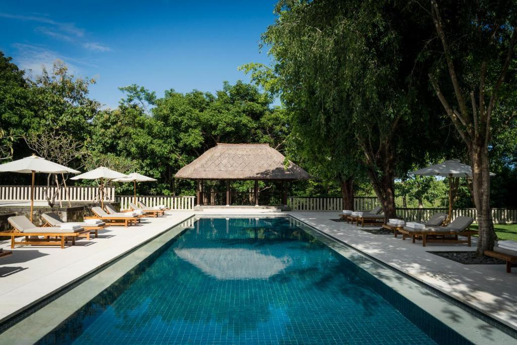 The swimming pool at or near REVĪVŌ Wellness Resort Nusa Dua Bali