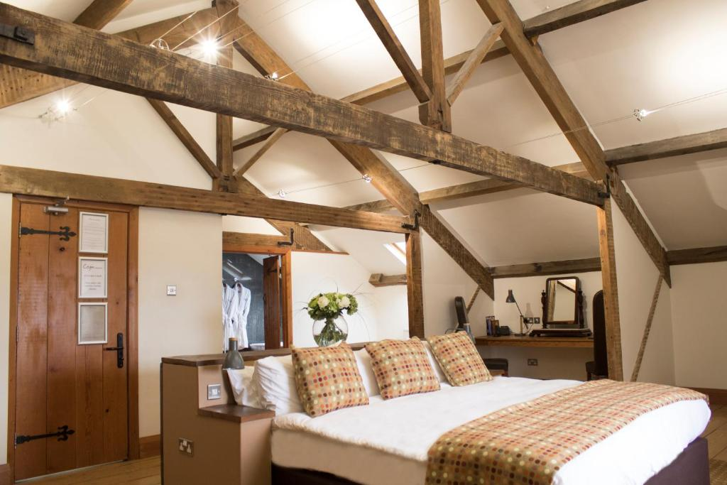 A bed or beds in a room at The Cawdor