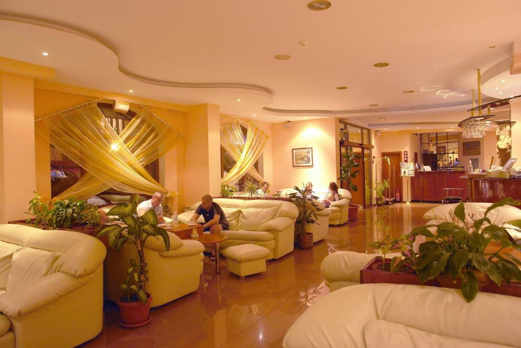 The lobby or reception area at Elegant Hotel