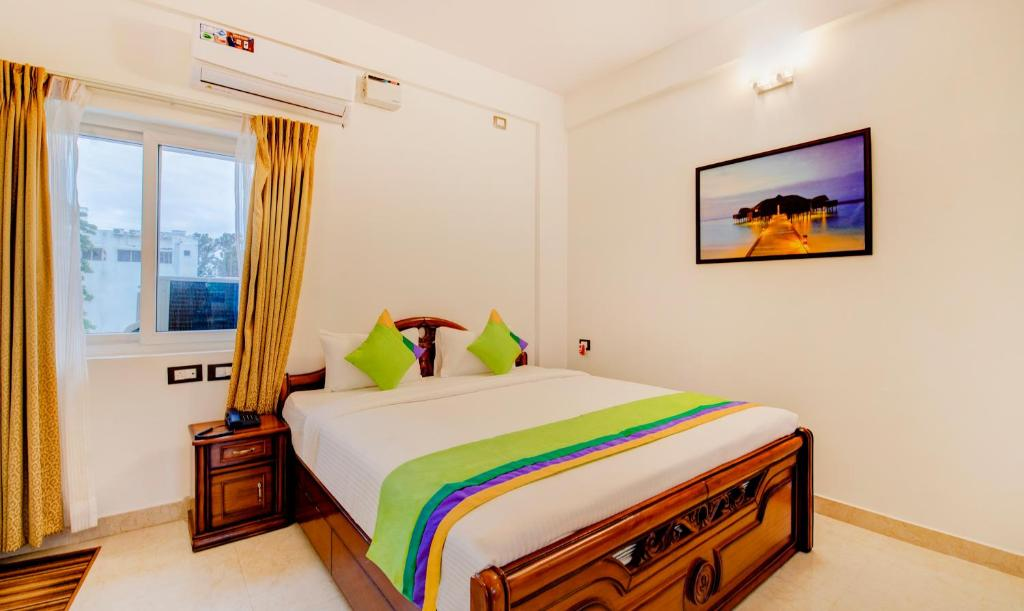 A bed or beds in a room at Treebo Trend Saffron Suites