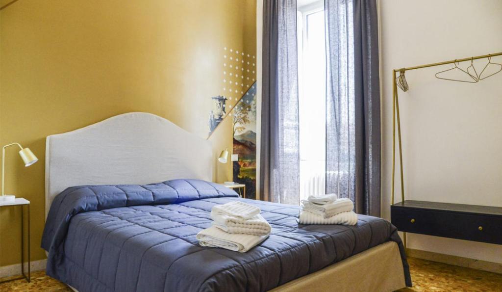 Cama o camas de una habitación en San Pietro Suite Rome