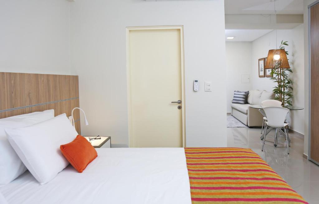 Una cama o camas en una habitación de The Point Casa Edificio Boutique