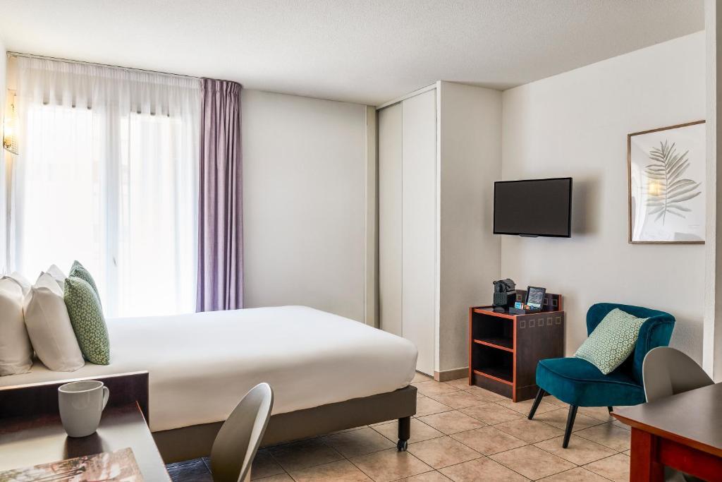 Un ou plusieurs lits dans un hébergement de l'établissement Aparthotel Adagio Access Nice Acropolis
