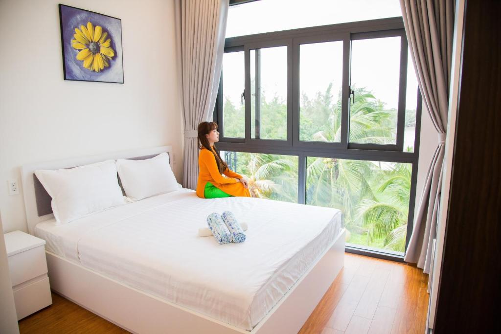 A bed or beds in a room at Melia Riverview