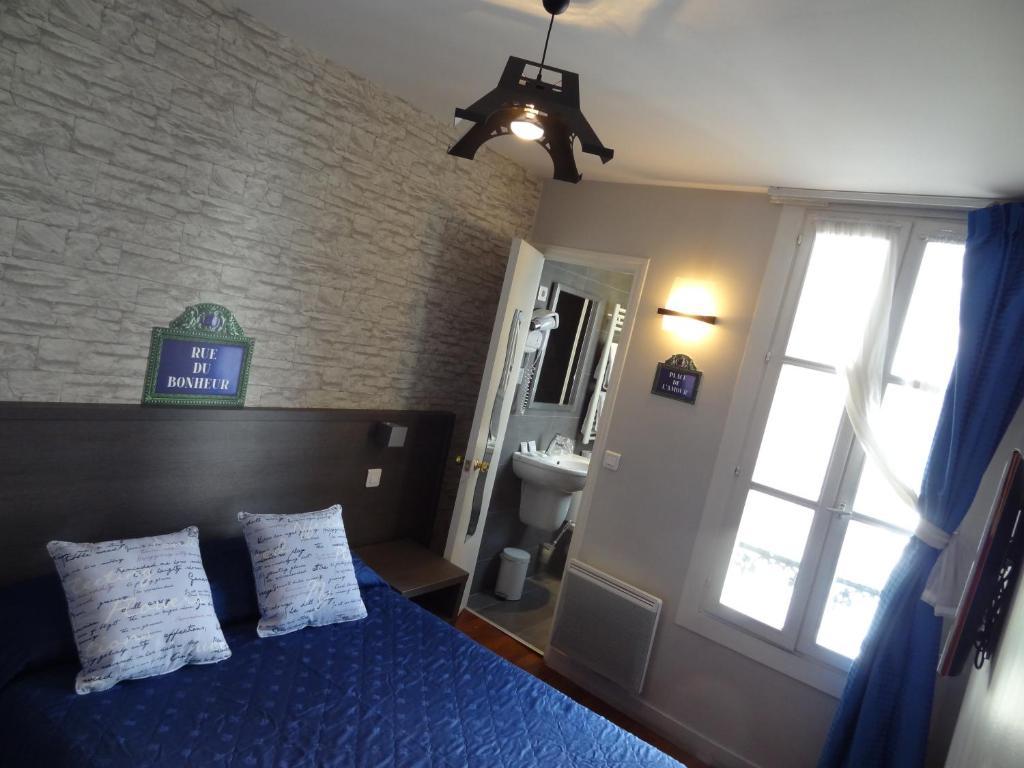 Cama ou camas em um quarto em Amélie Hotel