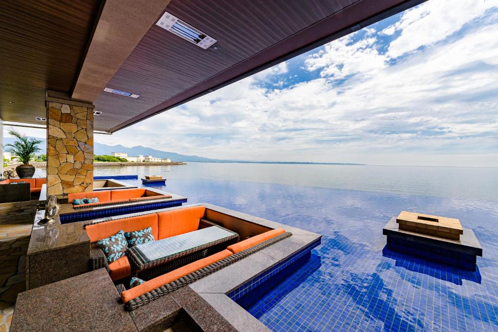 The swimming pool at or near AMANE resort SEIKAI
