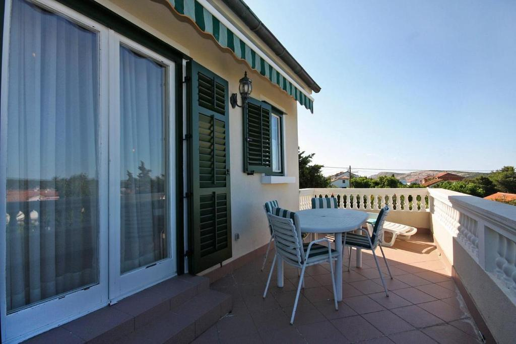 A balcony or terrace at Apartments by the sea Barbat (Rab) - 3203