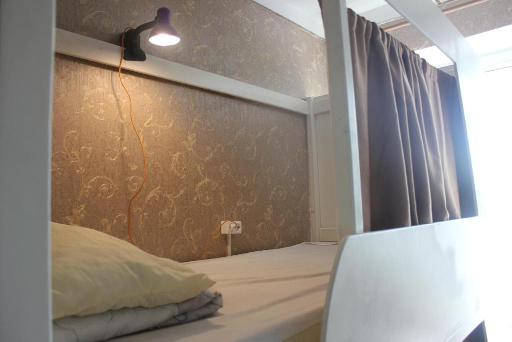 A bed or beds in a room at Hostel U Bashny
