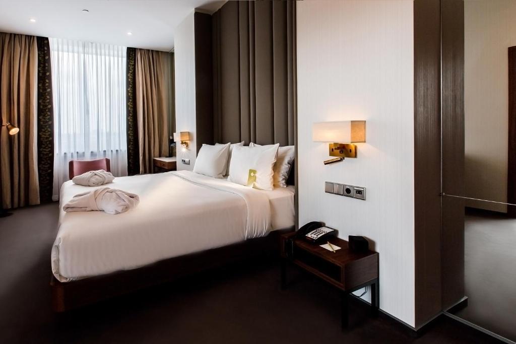Кровать или кровати в номере Hilton Garden Inn Volgograd