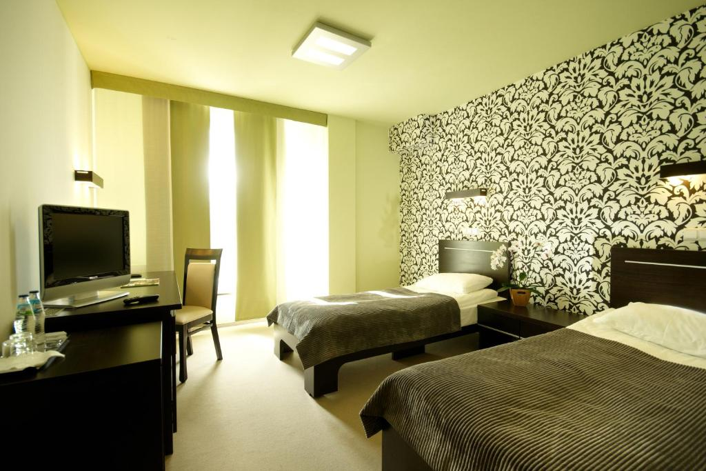 A bed or beds in a room at Hotton Hotel