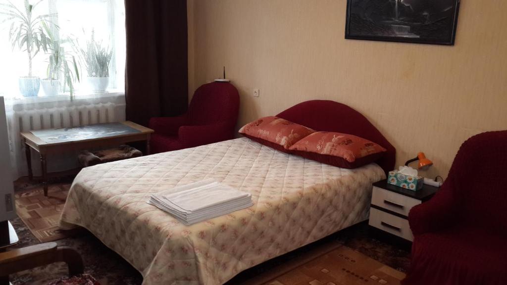 Кровать или кровати в номере Апартаменты на Ленина 70