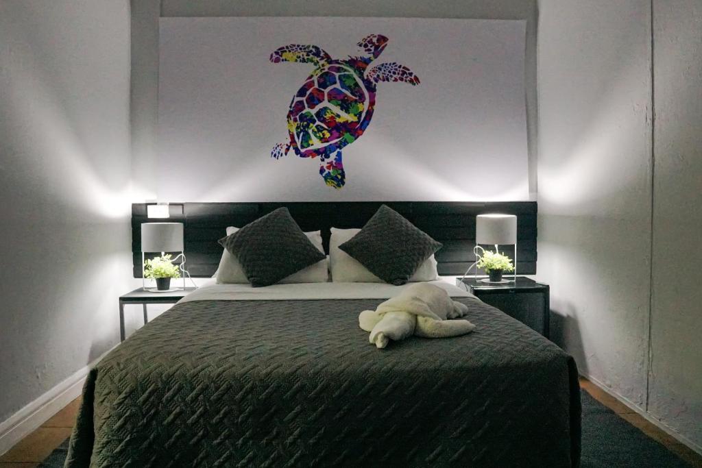 Cama o camas de una habitación en Turtle Saving Hostel