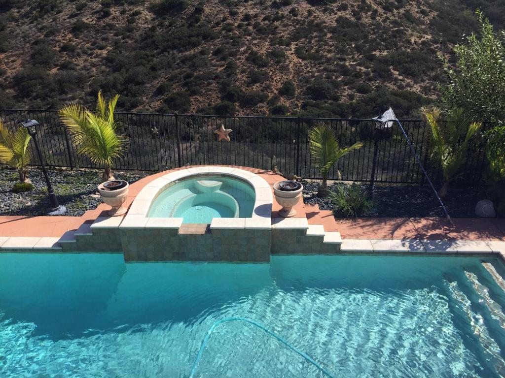 The swimming pool at or near Rooms in beautiful house on ocean view hills