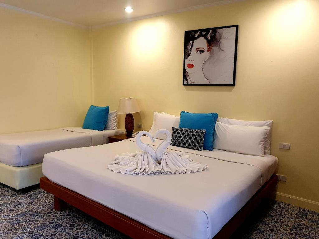A bed or beds in a room at Sabai Resort