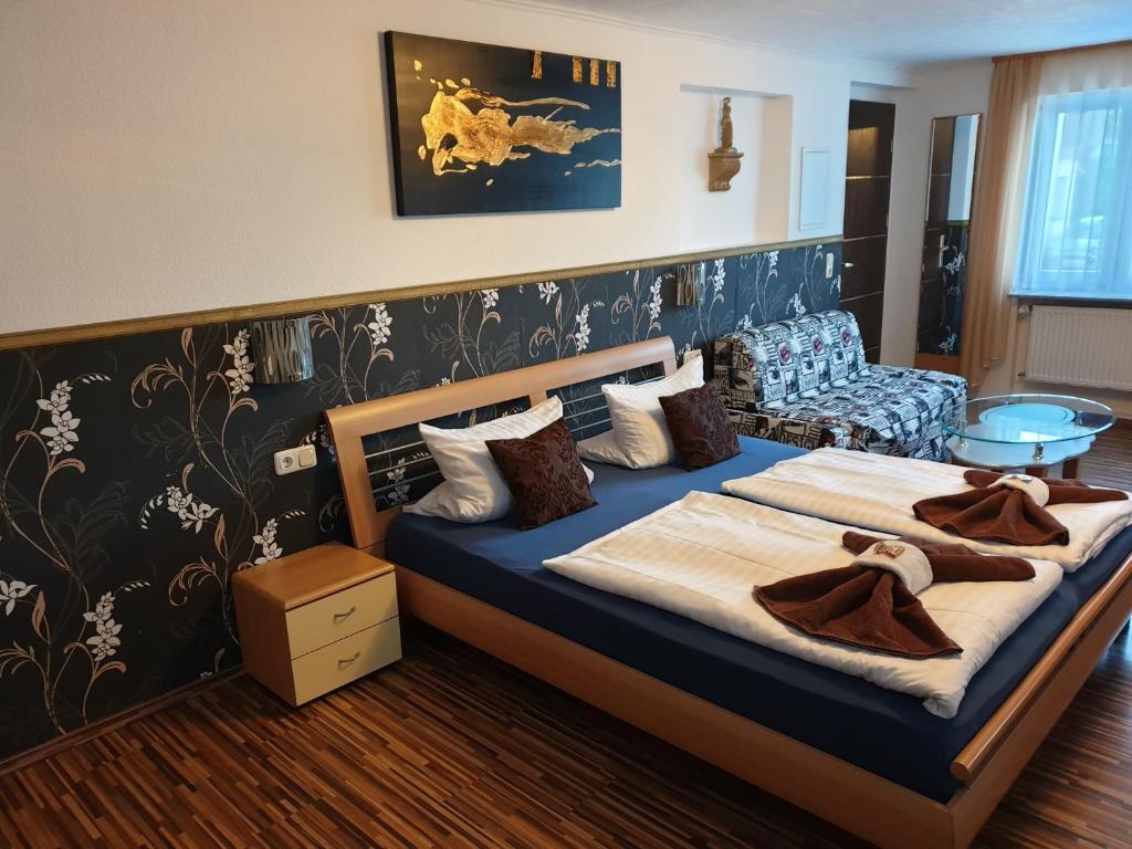 Ein Bett oder Betten in einem Zimmer der Unterkunft T&K Appartements