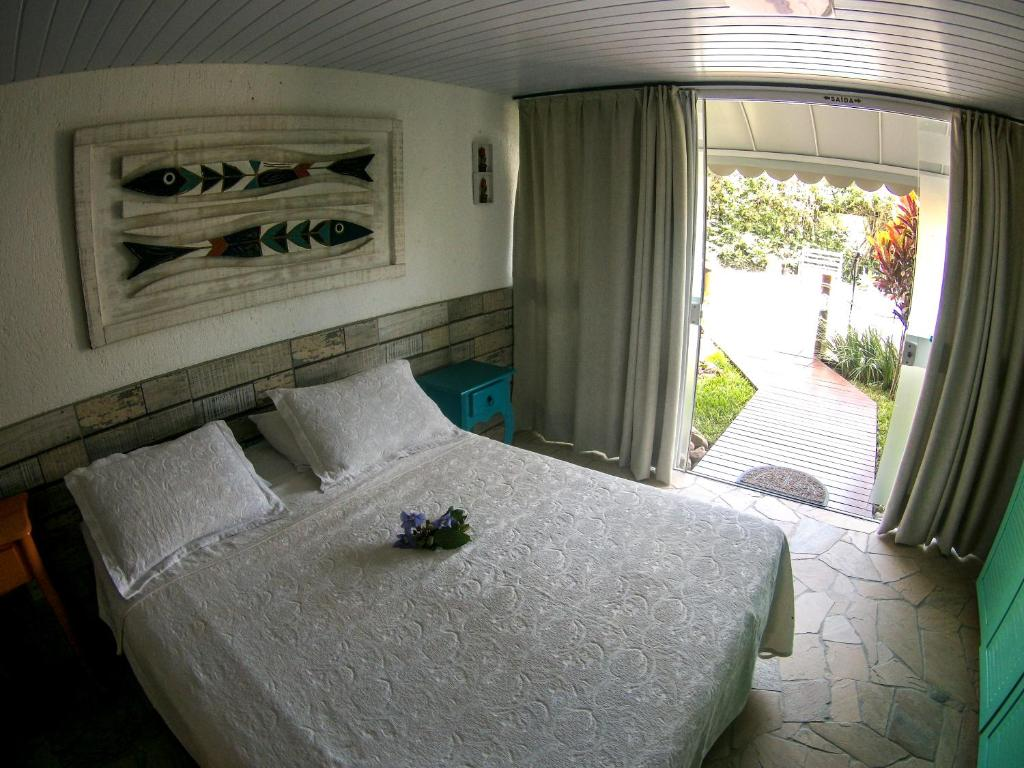 A bed or beds in a room at Morada Dos Ventos