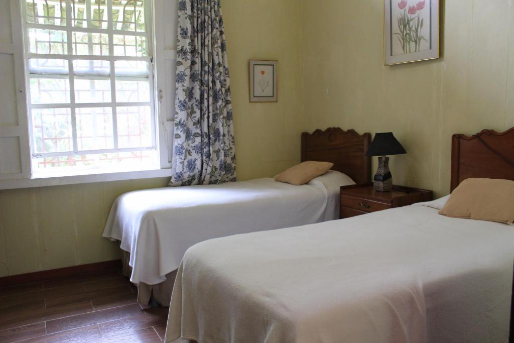 A bed or beds in a room at El Carmen Estate Hotel & Coffee Resort