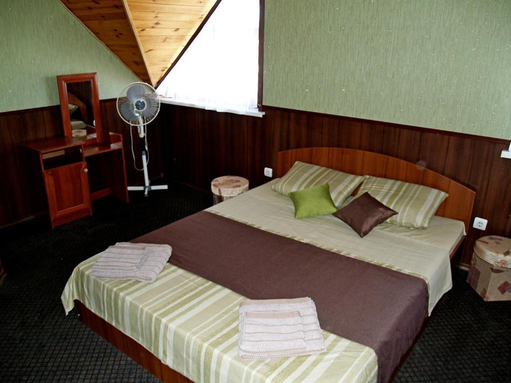 Кровать или кровати в номере Гостевой дом Дача