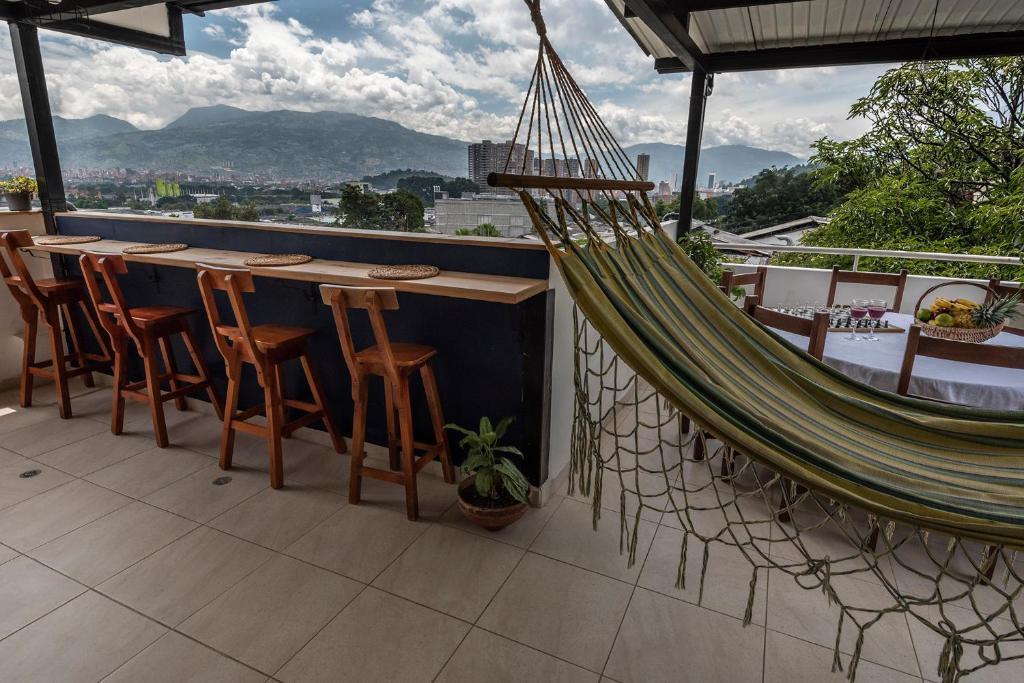 A balcony or terrace at Poblado Guest House