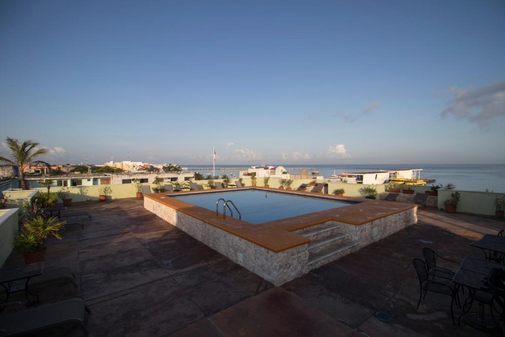 The swimming pool at or near Hotel Plaza Cozumel