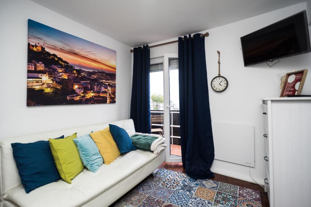 A seating area at Apartamento do Castelo