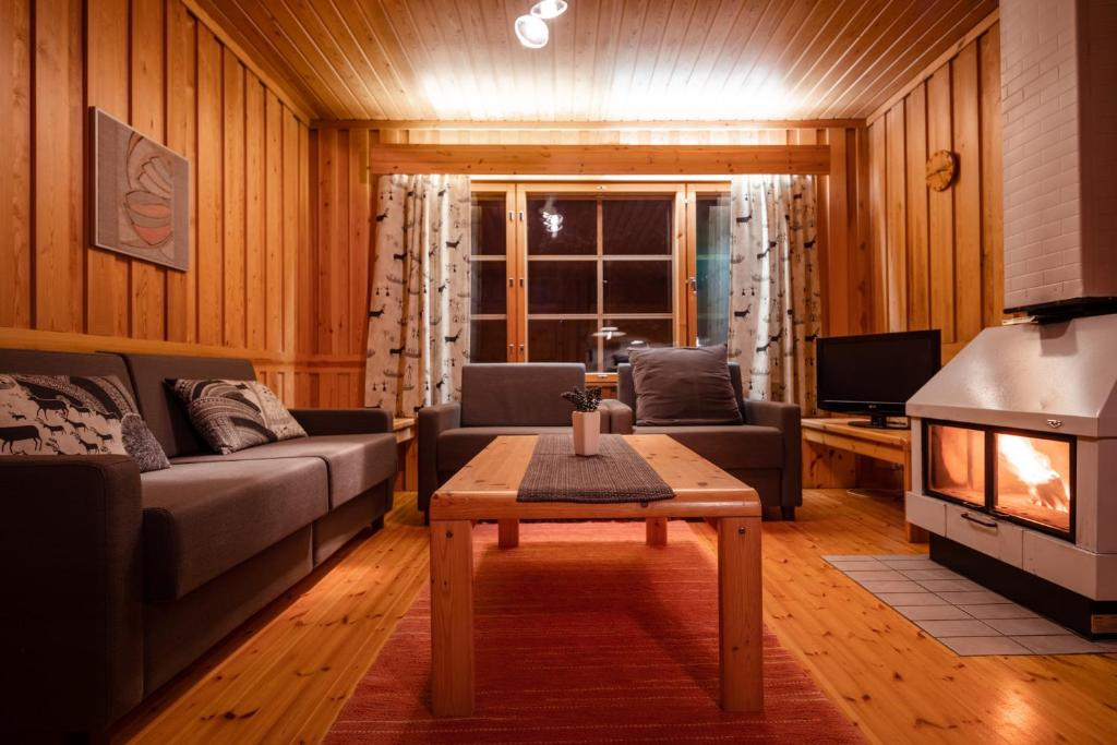 A seating area at Pyhän Asteli Log Cottages