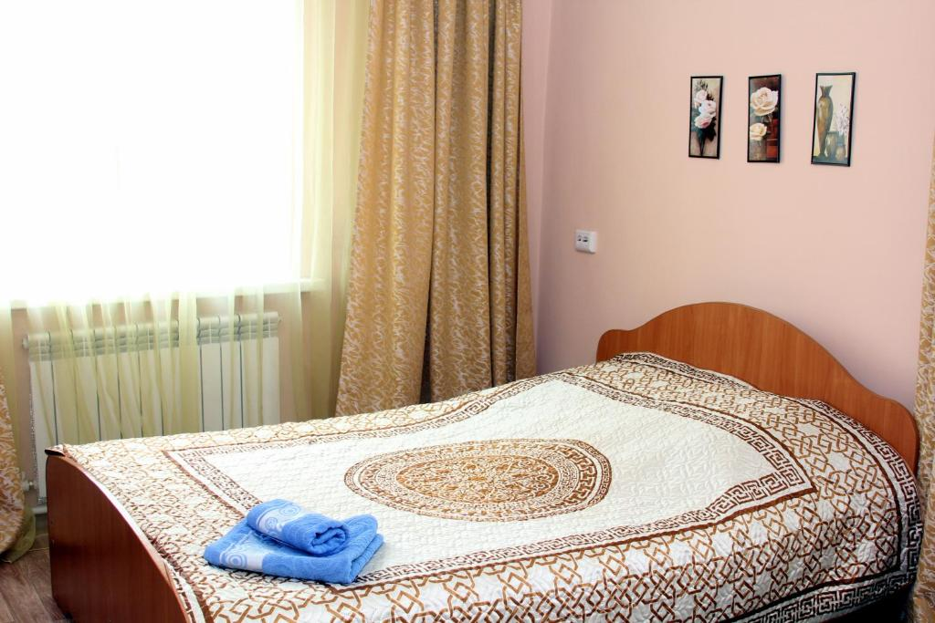 A bed or beds in a room at Guest House Bashkiriya
