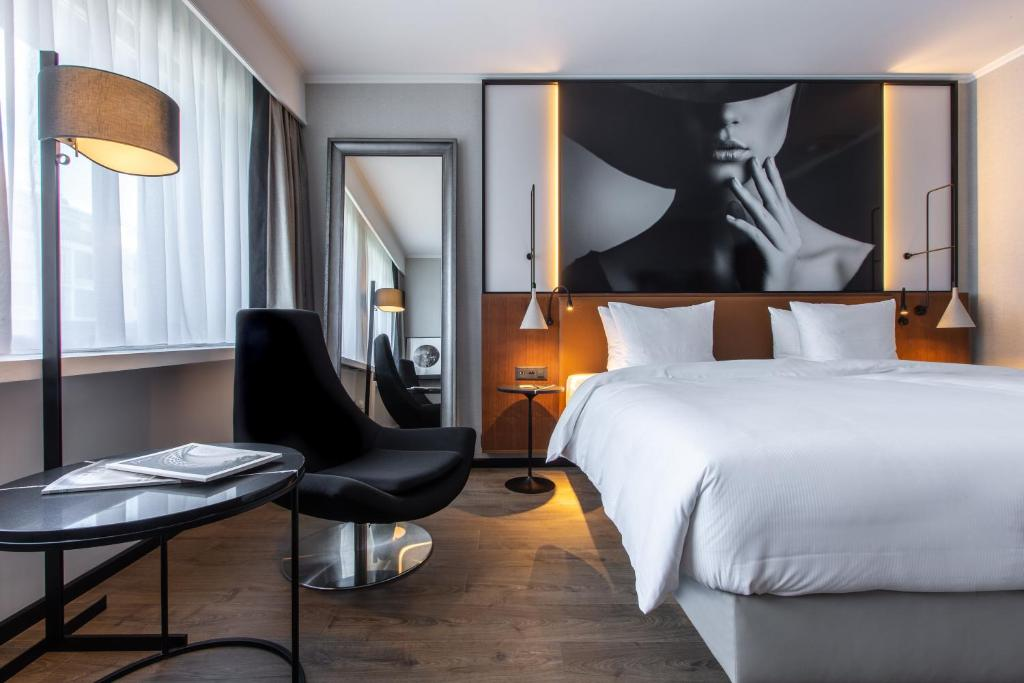 A bed or beds in a room at Radisson Blu, Basel