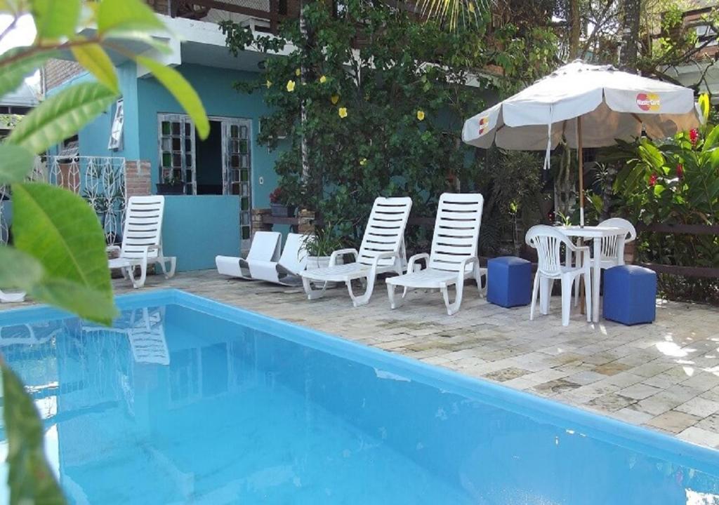 The swimming pool at or near Pousada Oca Poranga