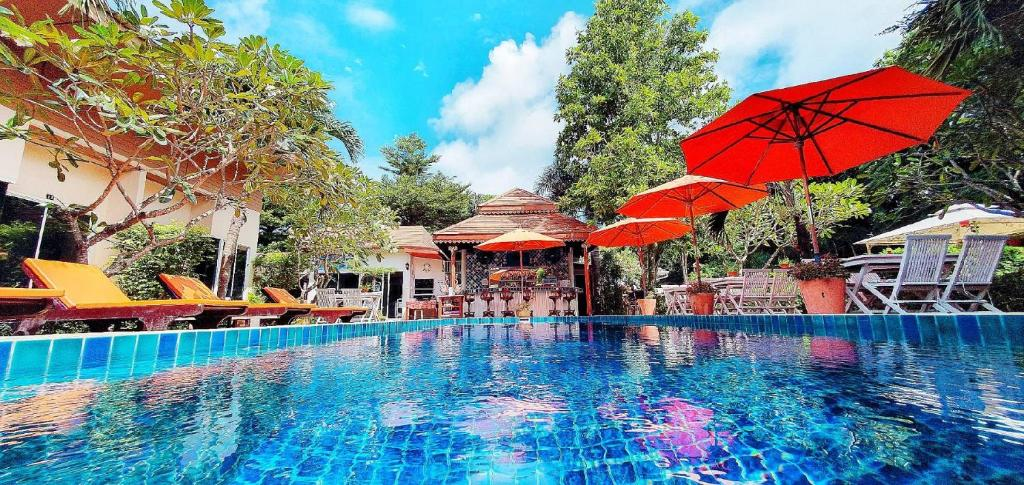 The swimming pool at or close to Cascades Boutique Resort Phuket