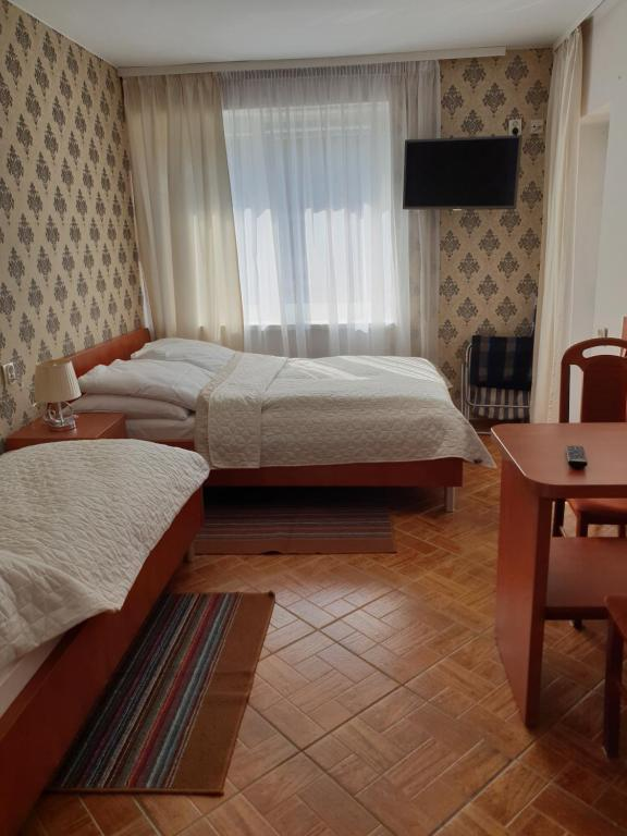 A bed or beds in a room at Dom Gościnny Ewa - 200 m od morza