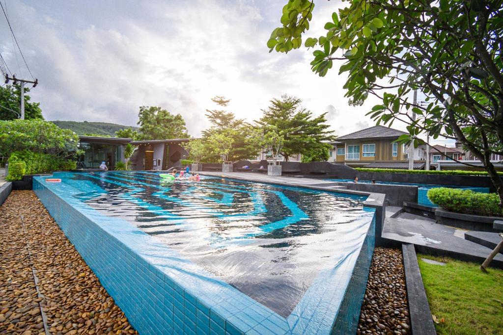 The swimming pool at or close to 4BR Villa @ Saransiri Phuket