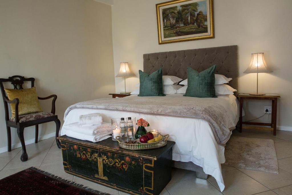 A bed or beds in a room at White Olive Family Guesthouse
