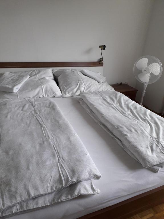 Ein Bett oder Betten in einem Zimmer der Unterkunft Salzburg Bahn Hof (Railway station) apartments