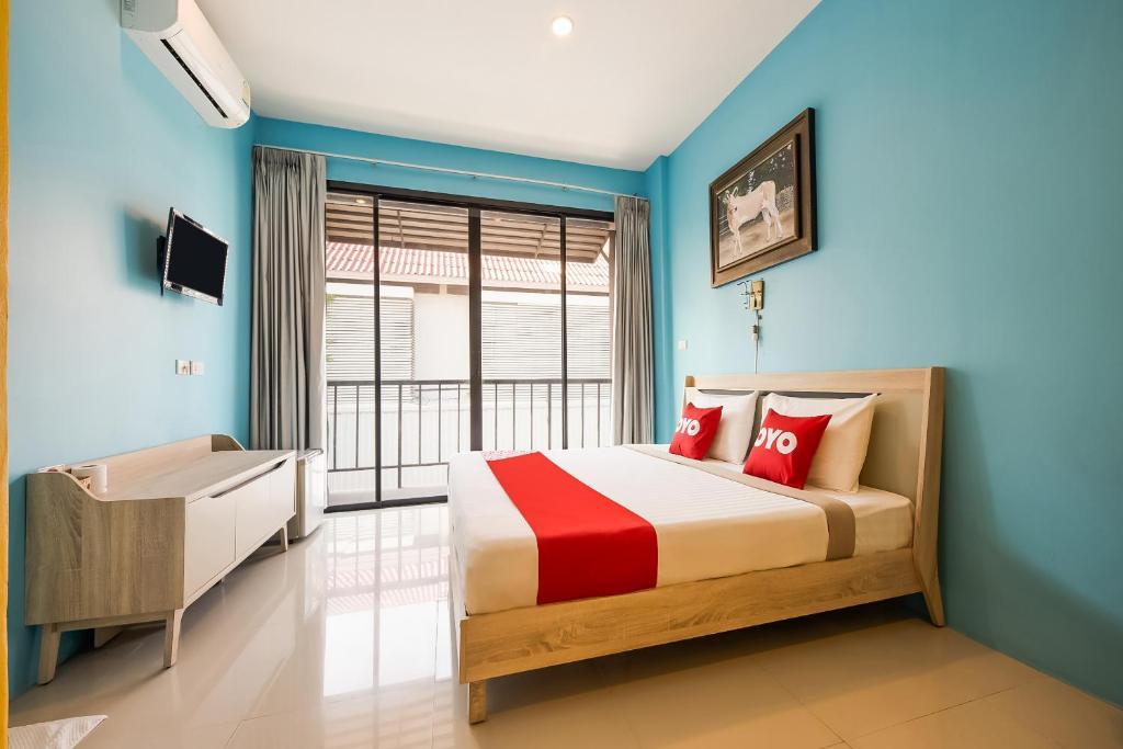 เตียงในห้องที่ OYO 269 Eyeda hotel Huahin