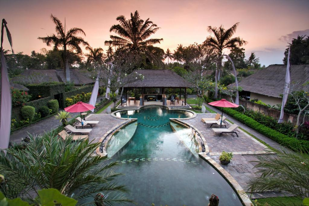 The swimming pool at or near FuramaXclusive Resort & Villas, Ubud