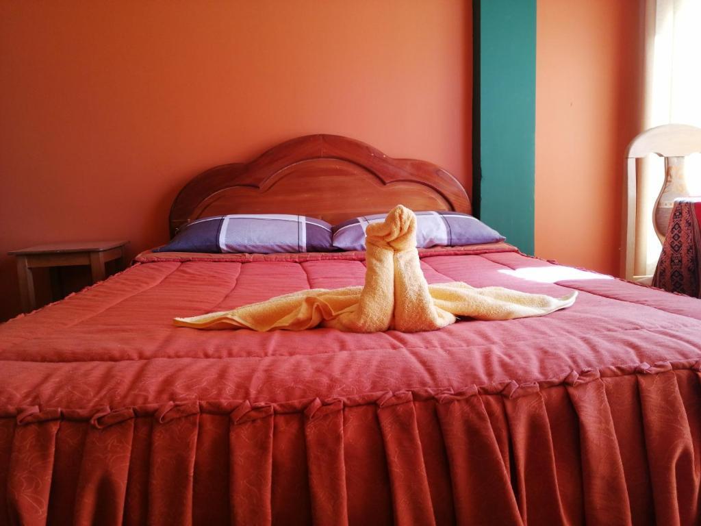Ein Bett oder Betten in einem Zimmer der Unterkunft Hostal Olas Del Titicaca