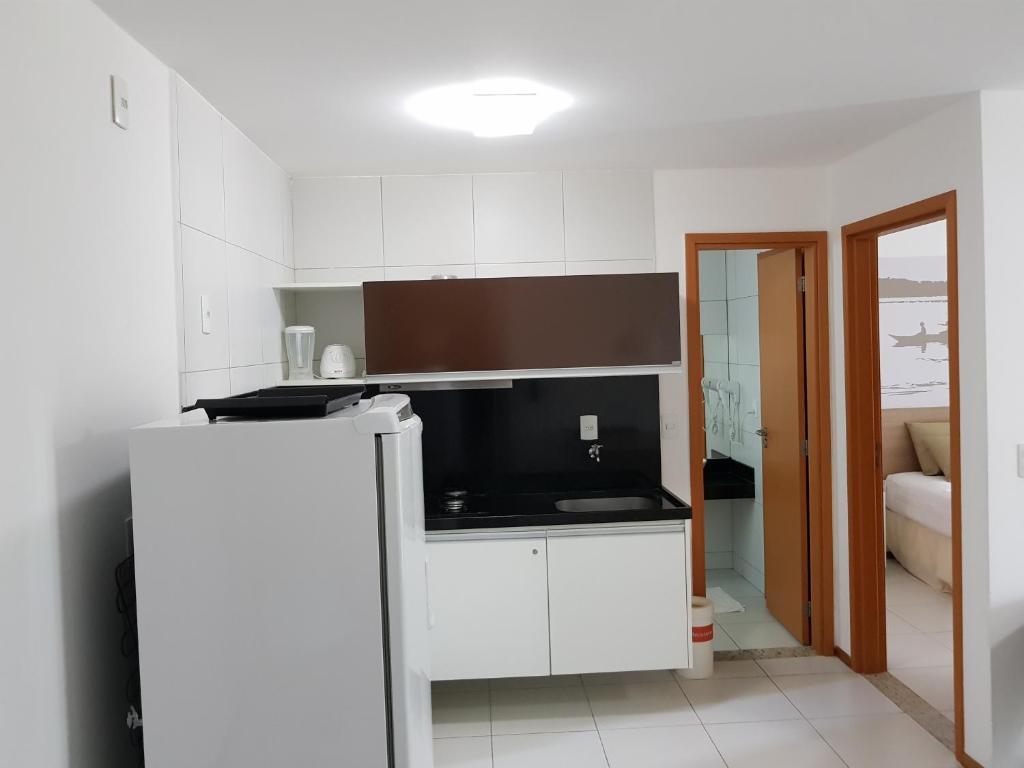 A kitchen or kitchenette at Residence Resort - Barra de São Miguel