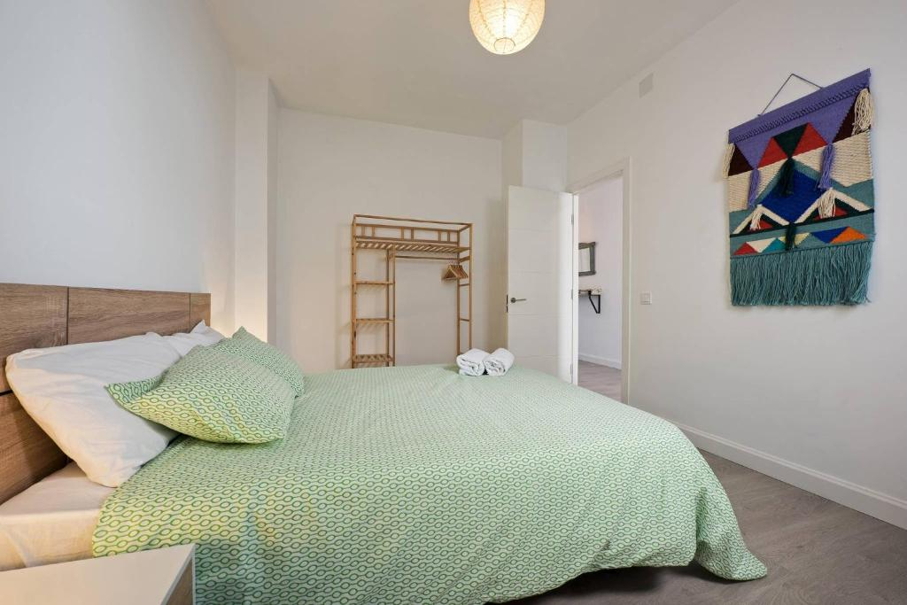 A bed or beds in a room at la Casita Andalusian Style Townhouse In Málaga