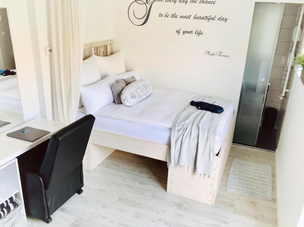 Een bed of bedden in een kamer bij BeachLounge Zandvoort