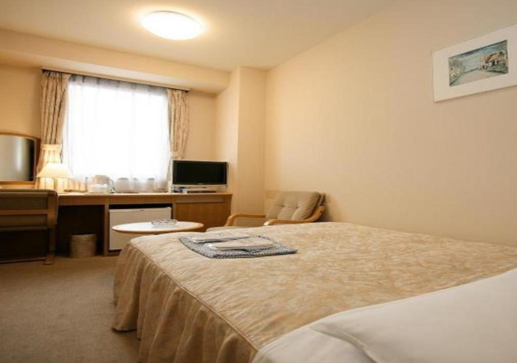 A bed or beds in a room at Narita U-City Hotel / Vacation STAY 42505