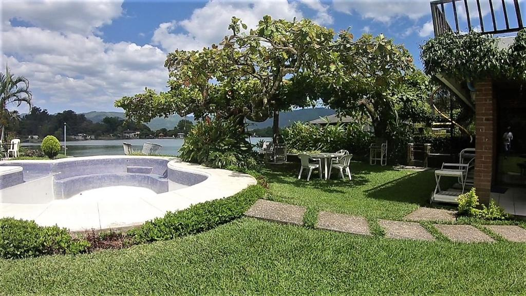 The swimming pool at or near Amatitlan Home AM004