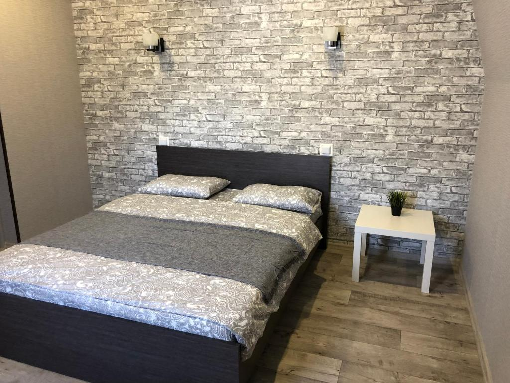 A bed or beds in a room at Ru hotel