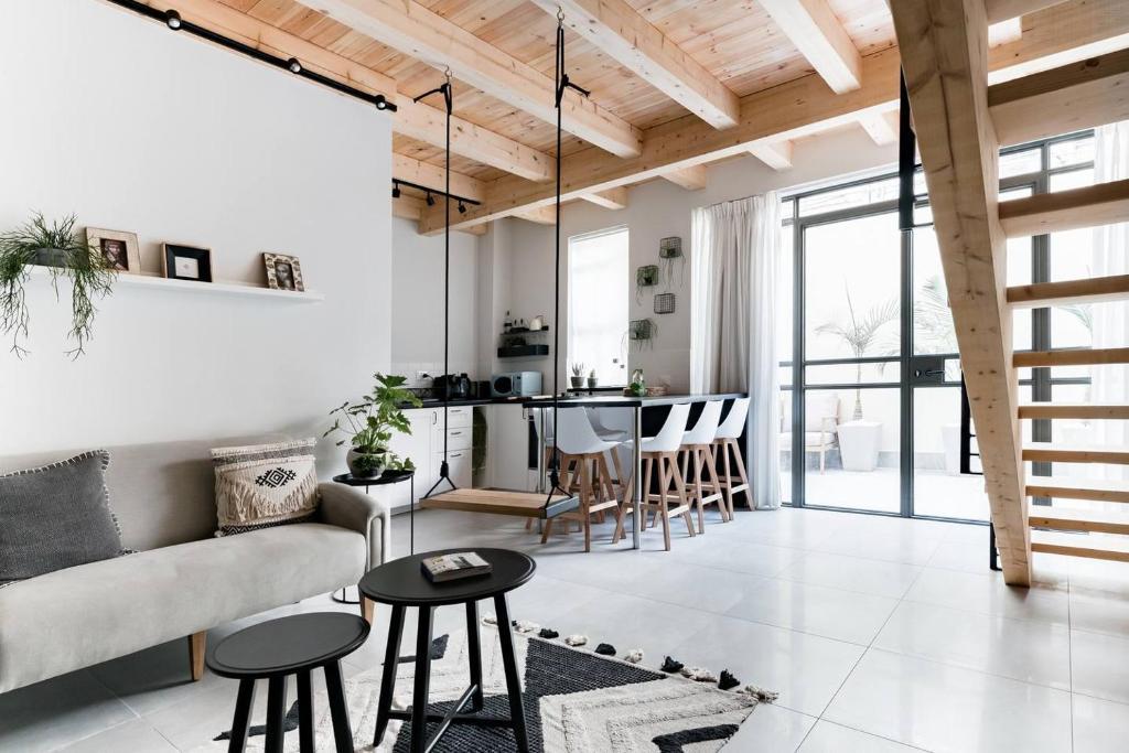 A seating area at Trust Inn - Florentine trendy new apt & terrace