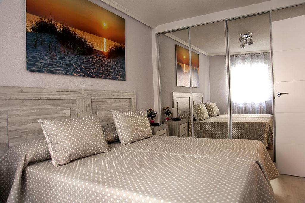 A bed or beds in a room at El Moderno Junto a Plaza del Oeste
