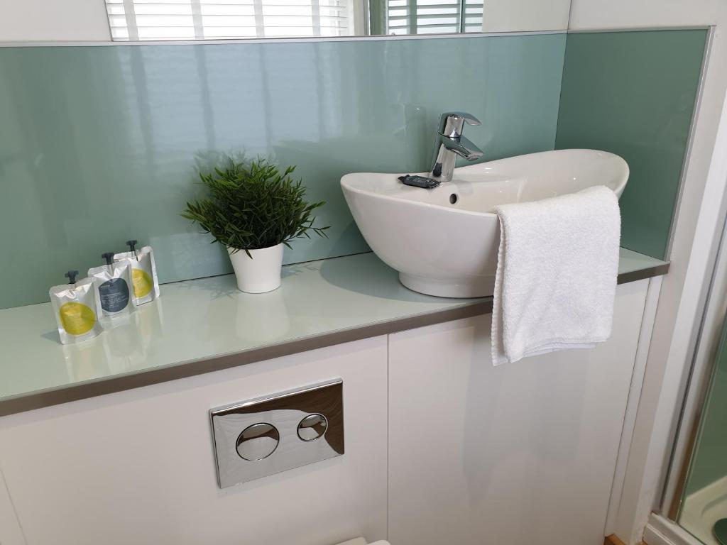 A bathroom at McMillan House Studio Apartments